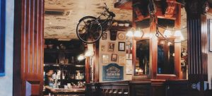 A bar is a place where meeting people in a new town often happens..