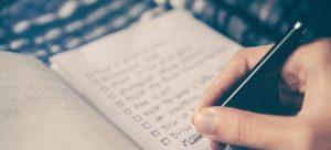 A person filling in a checklist.