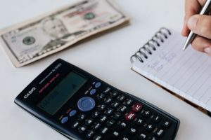 Calculator and a notepad to write down the costs when moving from Seattle to Jersey City.