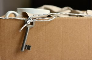 Some items packed in a cardboard box after finding affordable apartments in New Jersey.