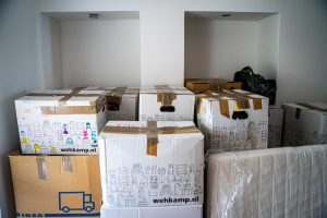 moving boxes ready for transportation after finding the right interstate moving company.