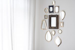 a collection of Moroccan mirrors on a wall