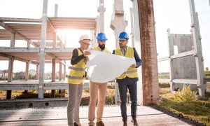 Architects on the construction site as one of the New Jersey real estate predictions for 2022 is that new buildings will be built.