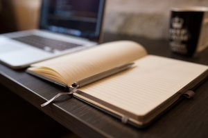 A notebook to write a strategy for overcoming the challenges of an international move.